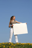 young woman holding blank cardboard with copyspace poster