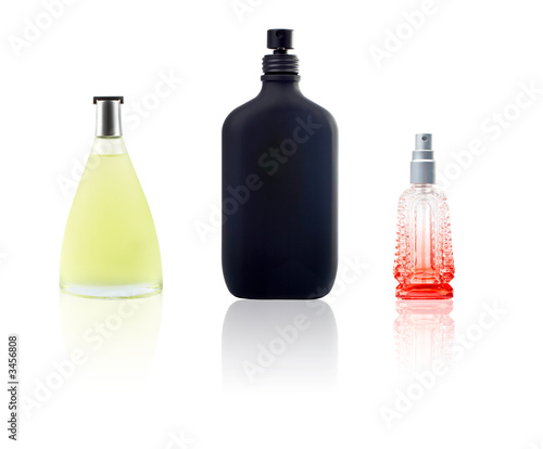 three bottle of perfum with reflection