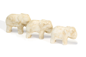 three marble elephants