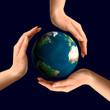 conceptual recycling symbol over earth globe
