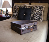 Retro vintage suitcase on bed poster