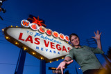 happy young woman at the welcome to las vegas sign poster