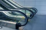 escalators in futuristic airport poster