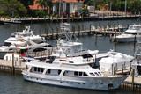 luxury yacht docked in marina poster
