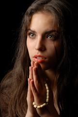 praying of repentant woman