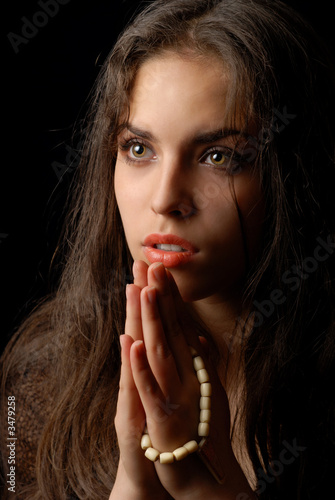 praying of repentant woman