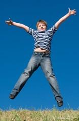 little boy jumps