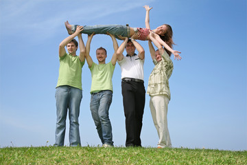 Four friends have lifted the girl upwards