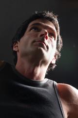 dramatic portrait of man exercising 3