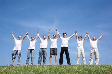 Seven friends in white shirts have waved hands