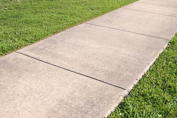 Abstract background of concrete sidewalk and grass