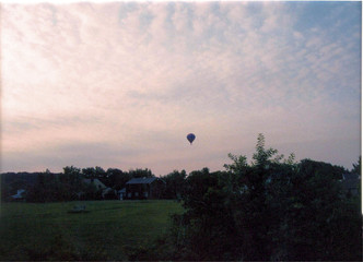 hot air balloon coming into  the morning