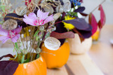 autumn decoration - flowers in pumpkins - narrow d