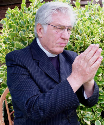 Vicar praying in the garden