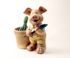 pig with a shovel and a cactus