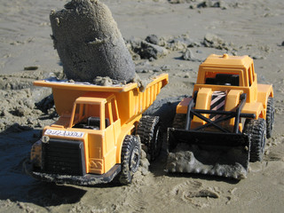 two yellow toy trucks