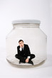 businessman locked in the jar
