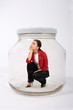 businesswoman locked  in the jar