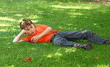 boy in park listening to mp3 player poster