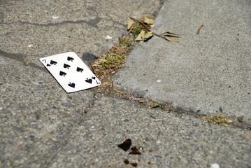 seven of hearts on sidewalk