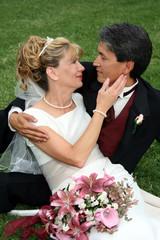 Bridal Couple Sitting On Grass