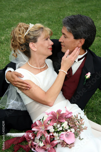 Bridal Couple Sitting On Grass