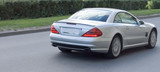 luxury car from behind, back view in motion