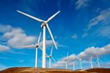 Wind turbines farm on sunset in winter