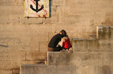 Couple embracing on the bank of the Seine poster