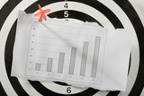 graph on white paper attach red  arrow to darts poster