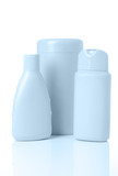 three blue cosmetics bottle with reflection on white poster
