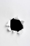black hole in white paper with ragged edges poster