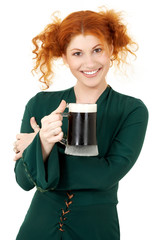 redhead in green dress with a mug of irish stout beer