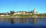 Old medieval czech castle with turrets, walls and a lake  poster