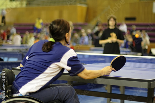 A disability female playing table tennis
