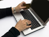 female hands with credit card,  typing order on laptop keyboard poster