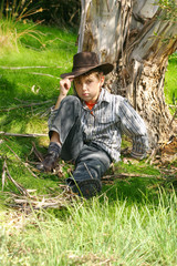A boy in rugged bushland in the outback ranges of Australia