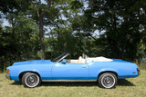 An immaculate blue 1971 Mercury Cougar convertible. poster