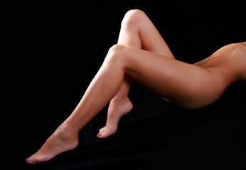Woman's legs on the black background