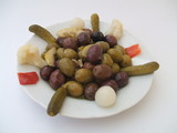 Appetizer. Preserves. Plate of mixed olives & pickles.  poster