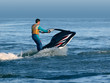 man stand on wave runner