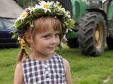 young cute girl with flowers in farm