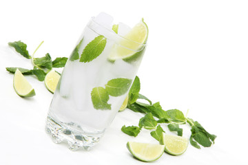 A mojito alcoholic drink over a white background