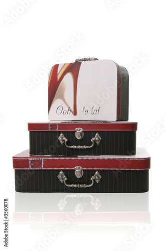 A stack of suitcase over a white background