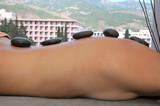 Hot stones massage treatment. poster