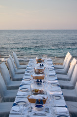 served table on the sea shore in resort