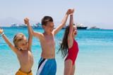 Three Children Wading in Ocean poster