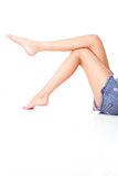 long slim female legs in jeans mini skirt poster