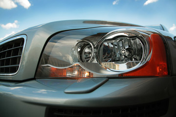 Headlight of the modern car close up