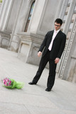 Man throws a bouquet of flowers to the ground  poster